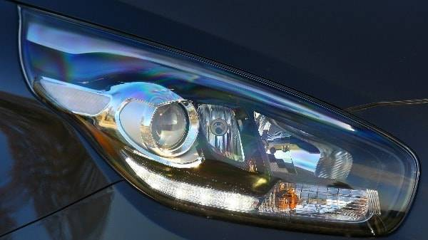 kia carens headlight