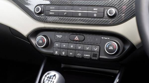 kia carens interior dash controls
