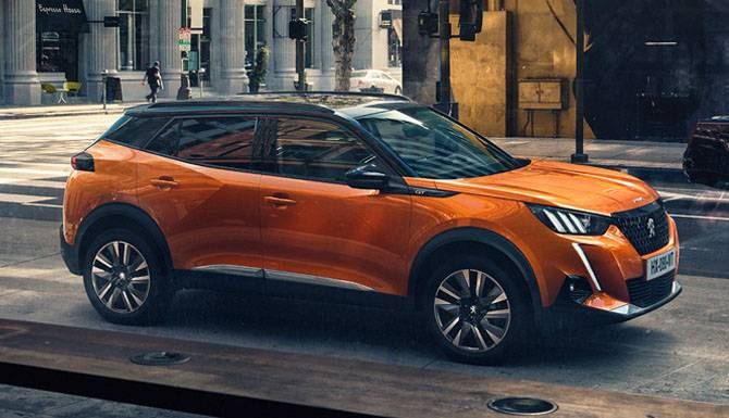 Peugeot 2008 SUV Orange On The Road 1